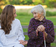 Elderly woman with the young doctor Royalty Free Stock Image