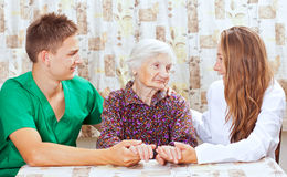 Elderly woman with the young doctor Stock Photography
