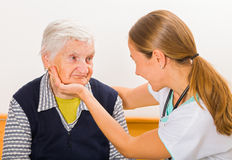 Elderly woman and young doctor stock photography