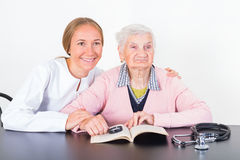 Elderly woman and young doctor Royalty Free Stock Photo