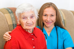 Elderly woman and young doctor Stock Images