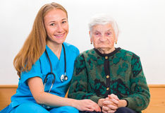 Elderly woman and young doctor Royalty Free Stock Photography