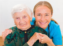 Elderly woman and young doctor Stock Photo