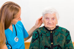 Elderly woman and young doctor Royalty Free Stock Images