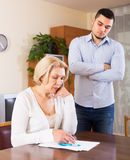 Elderly woman and young man with bills Royalty Free Stock Photography