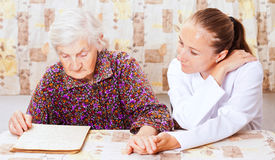 Elderly woman with the young smileing doctor Stock Photos
