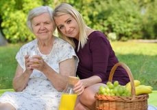 Elderly woman and young woman at the picnic. Royalty Free Stock Photos
