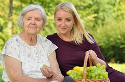 Elderly woman and young woman. stock photography