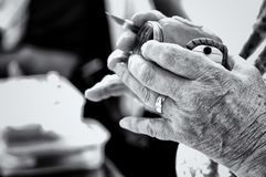 Elderly Womans Hands Crafting. Elderly woman's hands using a scapel to craft with modelling clay Royalty Free Stock Photo