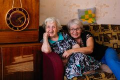Elderly woman with adult daughter posing for photo. royalty free stock photo