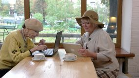 Elderly women in cafe. stock video
