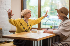 Elderly women and cafe table. Stock Photography
