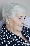 Elderly women in contemplation Stock Images