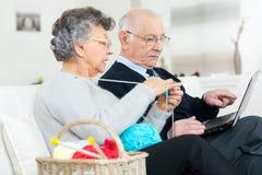 Elderly woman doing yarn hobby Royalty Free Stock Photos