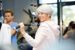 Elderly woman doing workout Royalty Free Stock Photo