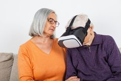 Watching virtual reality video with headset stock photo