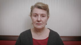 Elderly women and feelings, portrait of serious senior caucasian woman with severe look staring at camera. stock video footage
