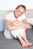 Elderly women in a lot of pain Royalty Free Stock Images