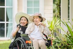 Elderly woman relax in backyard with daughter Royalty Free Stock Images