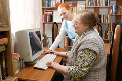 Elderly women study the computer Royalty Free Stock Photo