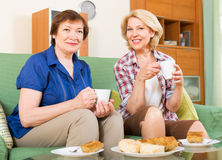 Elderly women at the table with tea Stock Images