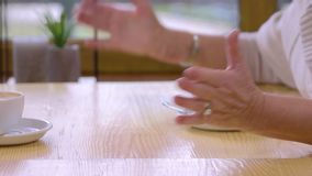 Elderly women touching hands. stock footage
