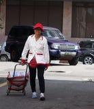 Elderly Yakult Lady Walking Down The Street