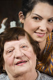 Elderly and young women family Stock Photos