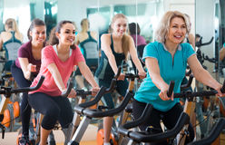 Elderly and young women working out hard in sport club Stock Photography