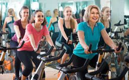 Elderly and young women working out hard in sport club. Happy russian elderly and young women working out hard in sport club Royalty Free Stock Photo
