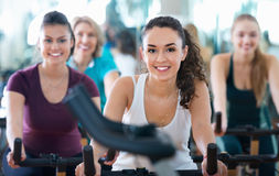 Elderly and young women working out hard in sport club Royalty Free Stock Images