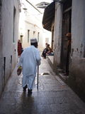 Elderly Zanzibar local in alleyway Royalty Free Stock Photo