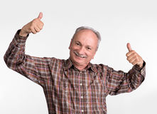Elderlyl man shows ok sigh Royalty Free Stock Photography