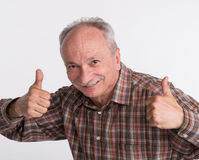 Elderlyl man shows ok sigh Royalty Free Stock Images