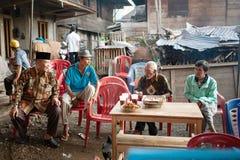 The elders are having breakfast and enjoying coffee
