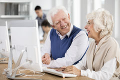 Elders making friends. Two elders making friends during group project on IT Stock Images