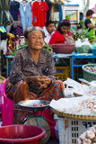 Elders of the market. PHICHIT THAILAND-JUNE 19: Elderly Woman aging of Thailand, which is still trading, onion and garlic in a vegetable market on the road royalty free stock image