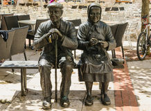 Elders statue. Statue of a couple of elders sitting on a bench. Burgos, Castile and Leon, Spain Royalty Free Stock Photo