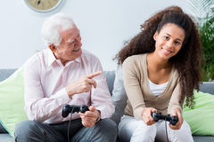 Elders winning in video games with youth Royalty Free Stock Images