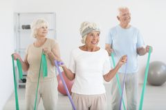Elders working out. Group of elders working out with exercise gum at the gym Stock Photo