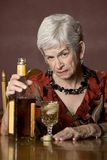 Eldery alcoholic woman Stock Photo