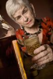 Eldery alcoholic woman Royalty Free Stock Image