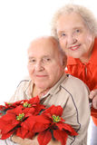 Eldery couple with flowers vertical. Isolated on a white background Royalty Free Stock Photos