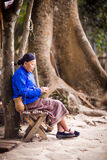 Eldery ethnic woman. Braiding a basket Royalty Free Stock Images