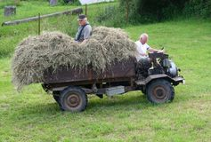 Eldery grandfather and son at the tractor, Czech Republic  Royalty Free Stock Photo