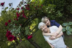 Eldery, gray woman with her daughter outdoors Royalty Free Stock Photography