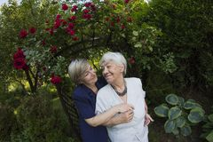 Eldery, gray woman with her daughter outdoors Royalty Free Stock Photos
