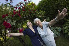 Eldery, gray woman with her daughter outdoors Stock Photo