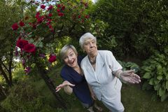 Eldery, gray woman with her daughter outdoors Stock Images