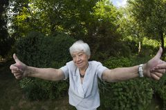Eldery, gray woman outdoors Stock Images